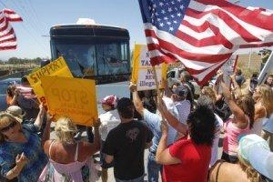 A plan to transport three busloads of Central American families through San Diego for processing at the Murrieta Border Patrol station took an unexpected turn when scores of protesters blocked the buses from entering.