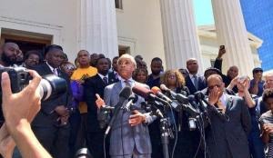 Al Sharpton speaks to a crowd at the St. Louis downtown courthouse