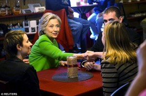 "Hillary Clinton has a ""spontaneous"" conversation with patrons at a coffee shop in Le Claire, Iowa."