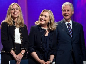 Chelsea, Hillary and Bill Clinton bask in the limelight.