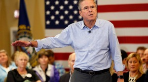 FILE - In this Sept. 30, 2015 file photo, Republican presidential candidate former Florida Gov. Jeb Bush speaks during a campaign stop in Bedford, N.H. Potential voters who take their curiosity about presidential candidates to Google are interested in Hillary Clinton's age, Jeb Bush's height, Chris Christie's weight, Donald Trump's net worth, Carly Fiorina's marital status and Bobby Jindal's birthplace. Those were among the top questions that the Internet search engine was asked about each candidate over the past couple of months.  (AP Photo/Jim Cole, File)
