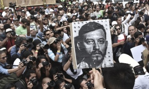 Mexican photojournalists hold pictures of their murdered colleague Rubén Espinoza during a demostration held at the Angel of Independence square in Mexico City. Photograph: Yuri Cortez/AFP/Getty Images