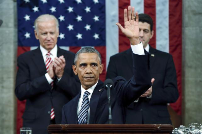 U.S. President Obama waves at the conclusion of his final State of the Union address to a joint session of Congress in Washington