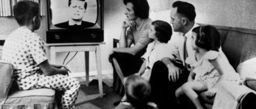 family-gathered-around-tv-500x214
